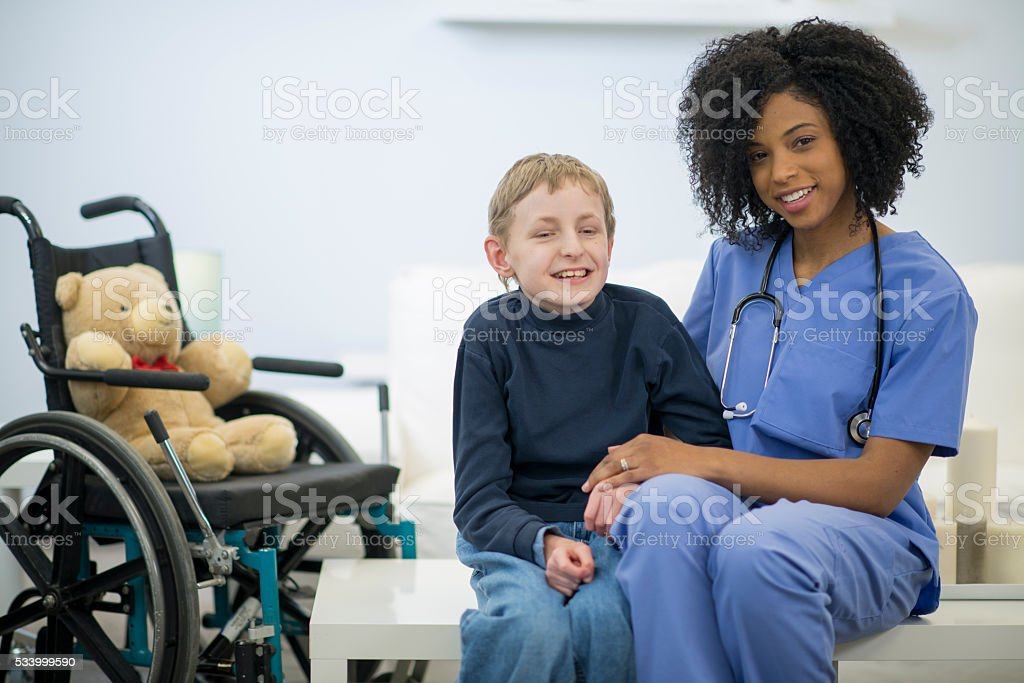 Nurse Helping a Disabled Child stock photo