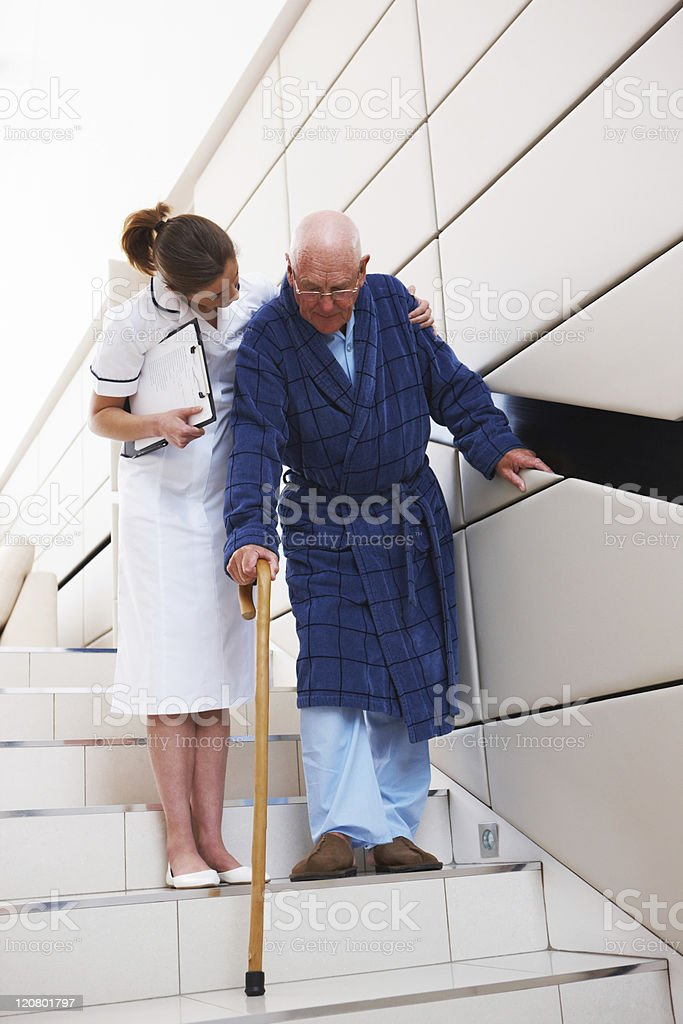 Nurse Helping a Patient Descend Stairs royalty-free stock photo