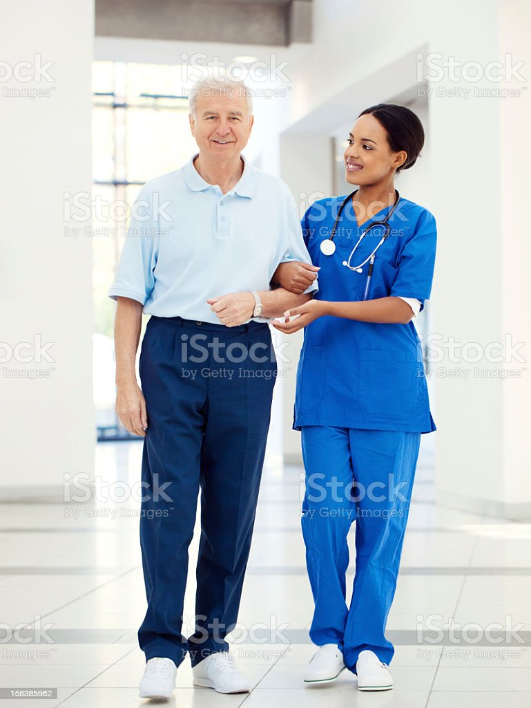 Nurse helping a senior patient stock photo