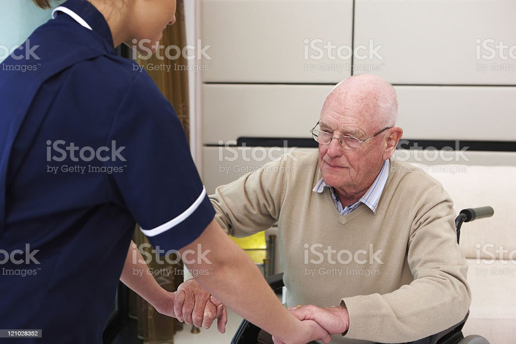 Nurse Helping an Elderly Man to Stand royalty-free stock photo