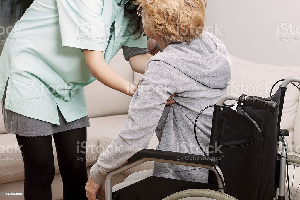 Nurse helping disabled woman royalty-free stock photo