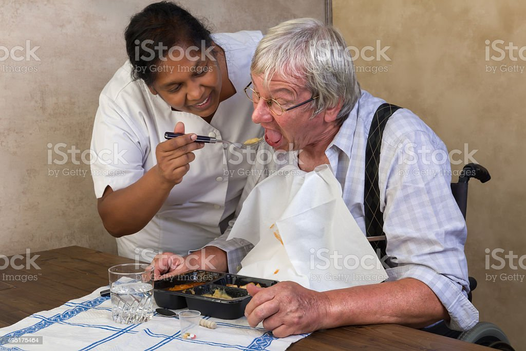 Nurse helping elderly man stock photo