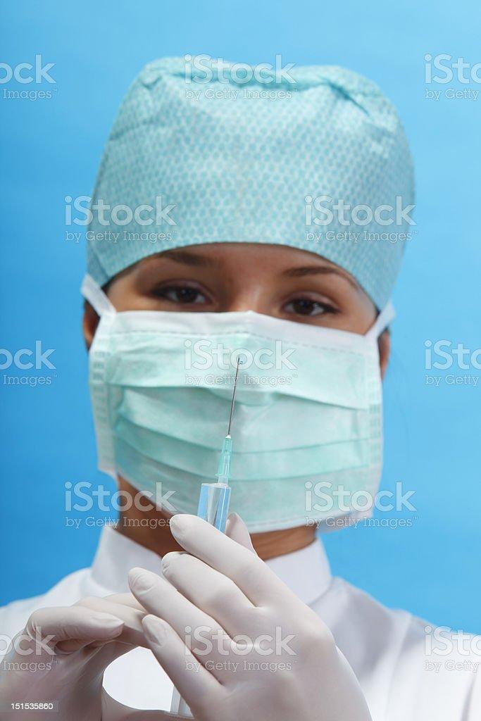 Nurse holding a syringe royalty-free stock photo
