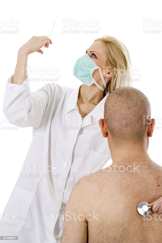 nurse holding syringe getting ready for an injection royalty-free stock photo
