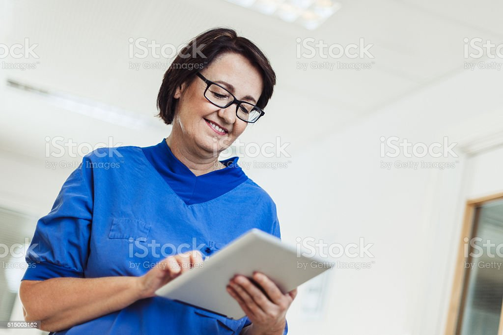 Nurse in hospital with digital tablet stock photo