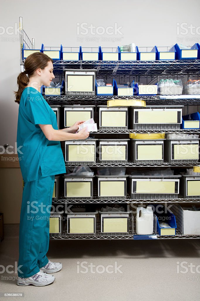 Nurse in Intensive Care Unit Supply Room stock photo