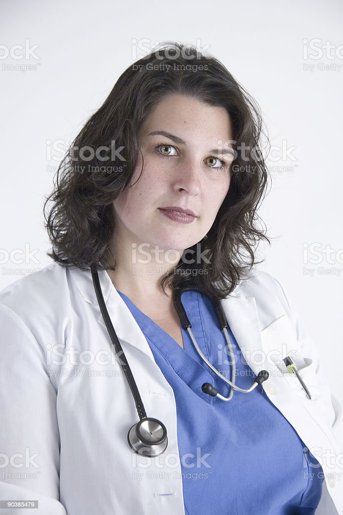 Nurse in scrubs and lab coat royalty-free stock photo