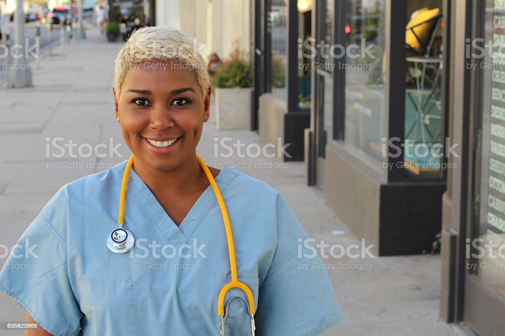 Nurse in the city streets heading to work stock photo