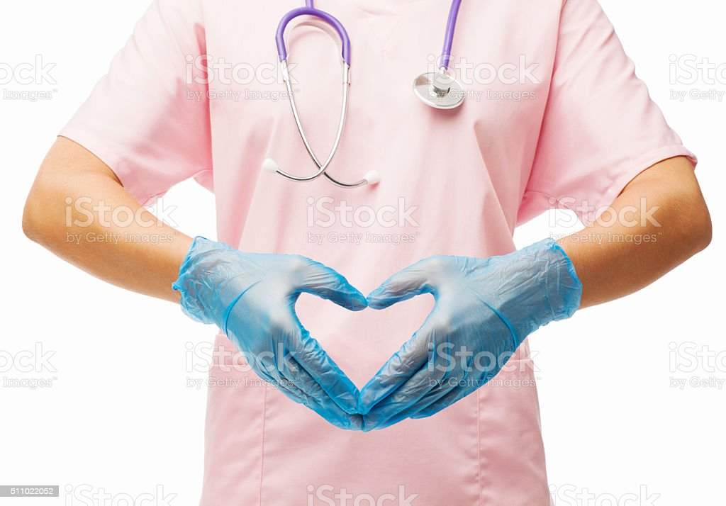 Nurse Making Heart Shape With Her Hands stock photo