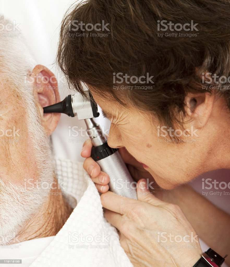 Nurse or Doctor Using Otoscope royalty-free stock photo