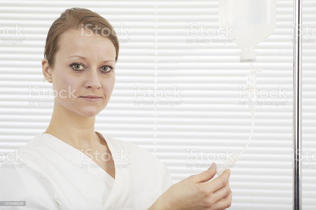 Nurse preparing a IV drip royalty-free stock photo