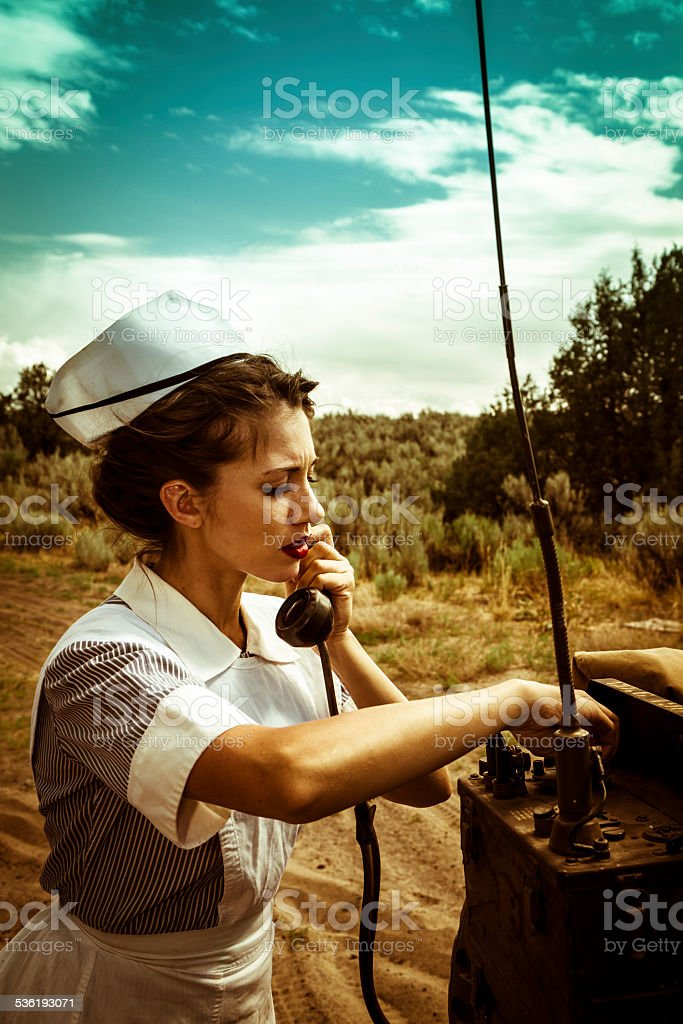 WWII Nurse Radios For Help On A Battlefield Telephone stock photo