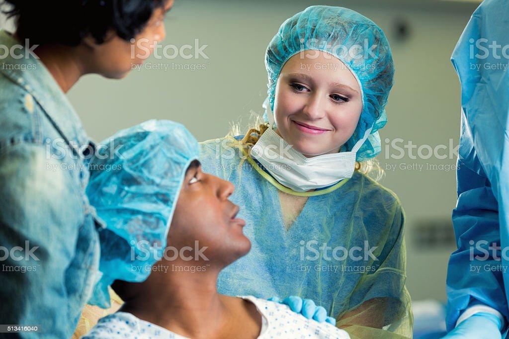 Nurse reasurres patient before surgery stock photo