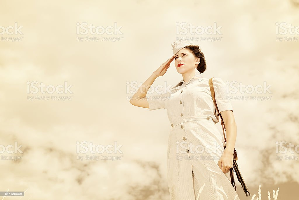 WWII Nurse Saluting Off Into The Distance stock photo