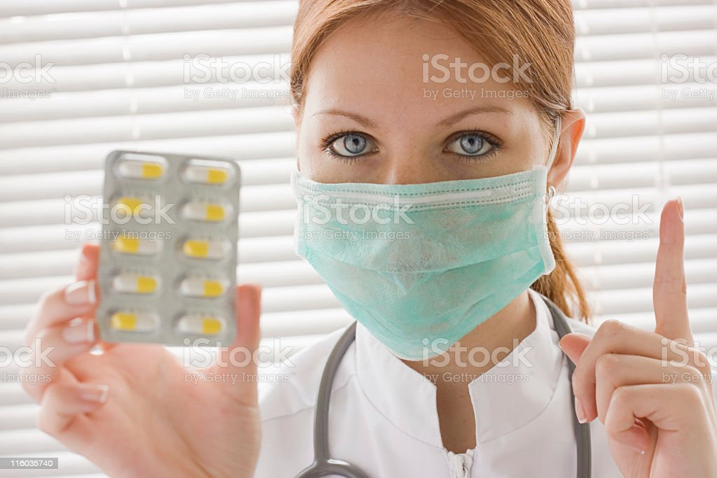 Nurse show yellow pills pack royalty-free stock photo