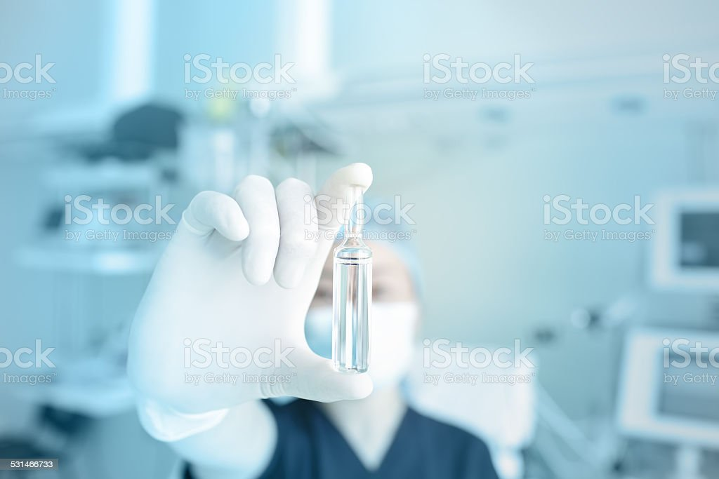 Nurse showing drug in hospital stock photo