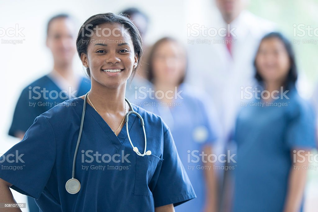 Nurse Smiling at Work stock photo