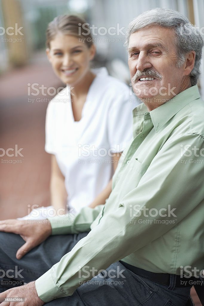 Nurse spending quality time with patient royalty-free stock photo