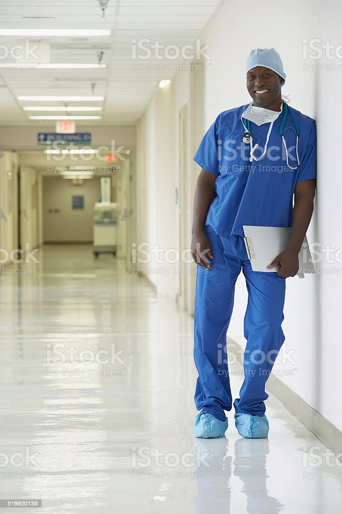 Nurse standing in a hospital corridor stock photo