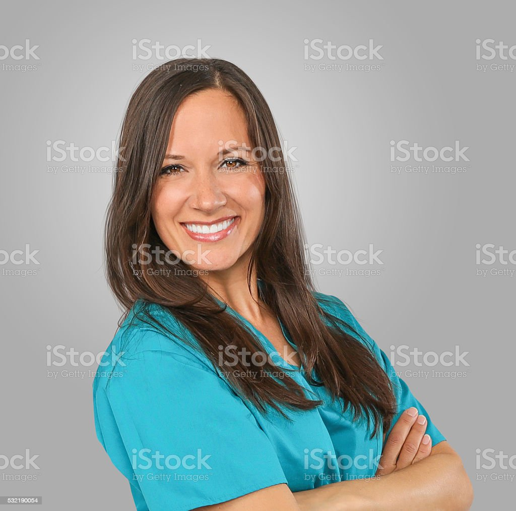 Nurse standing isolated over white background mixed race woman n stock photo