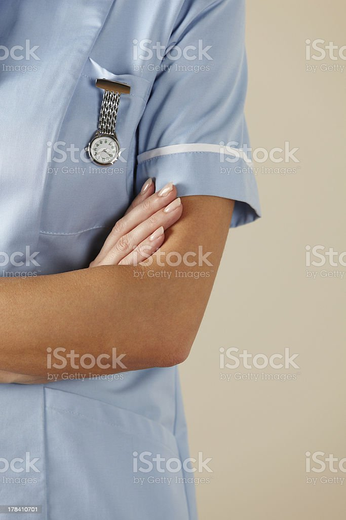 UK nurse standing with arms folded stock photo