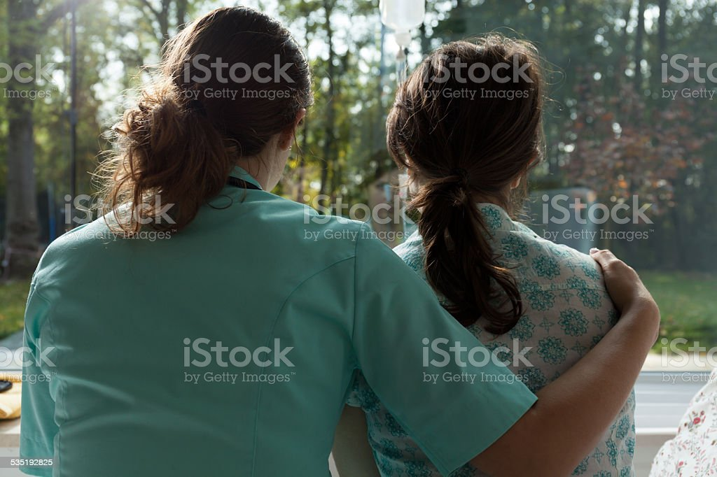 Nurse take care of sad patient stock photo