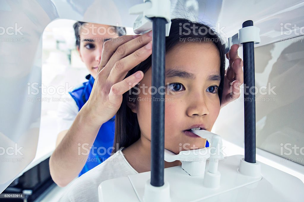 Nurse taking a CAT scan to a child stock photo