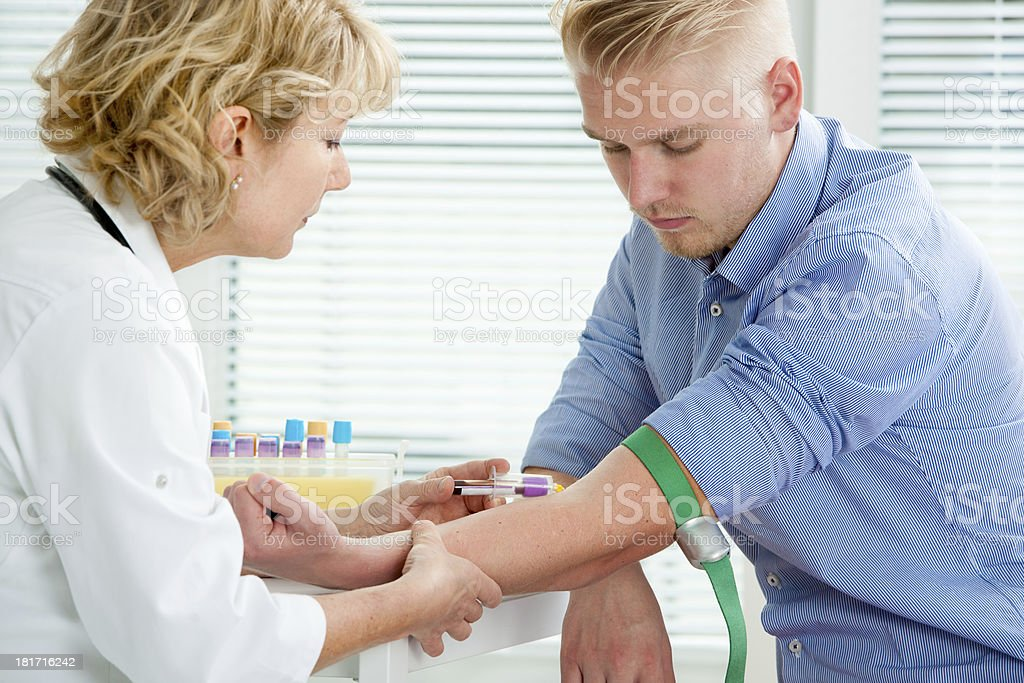 Nurse taking blood sample stock photo