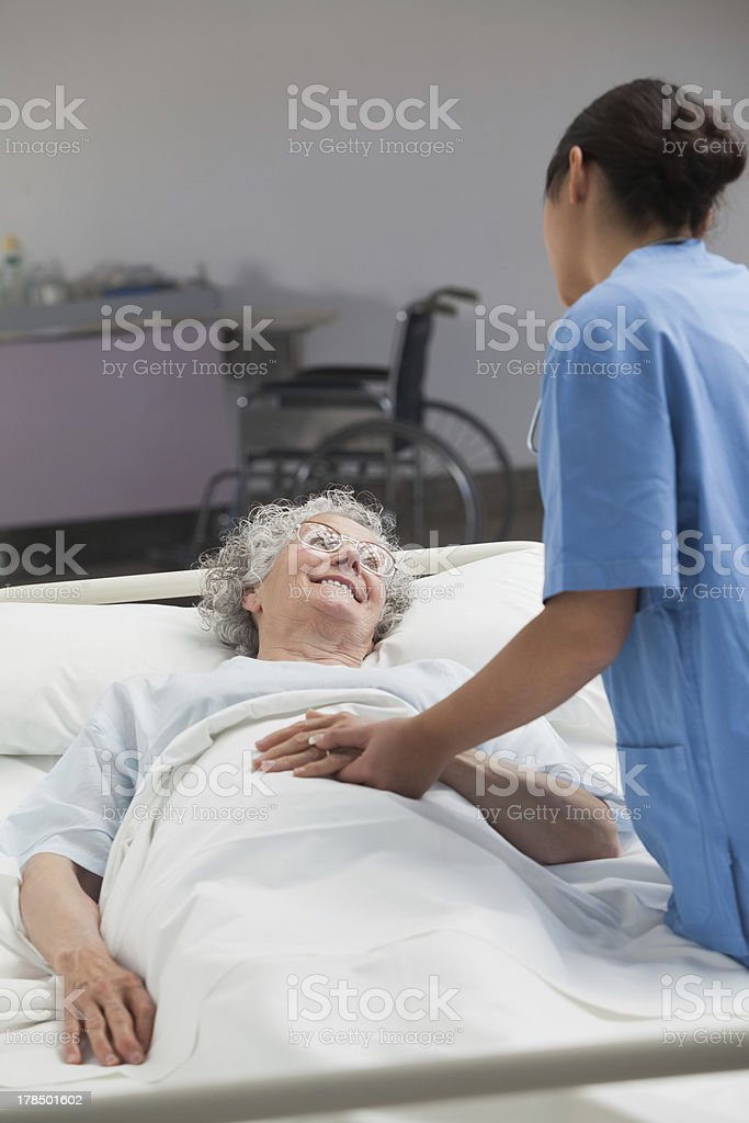 Nurse taking care of an elderly patient royalty-free stock photo