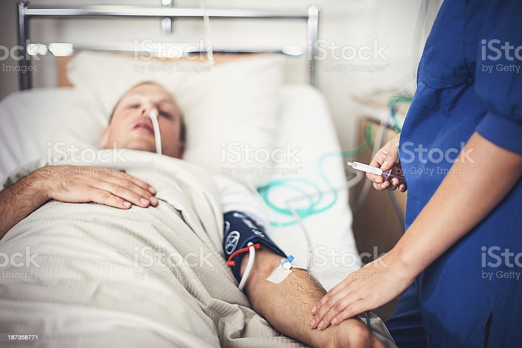 Nurse taking care of patient stock photo
