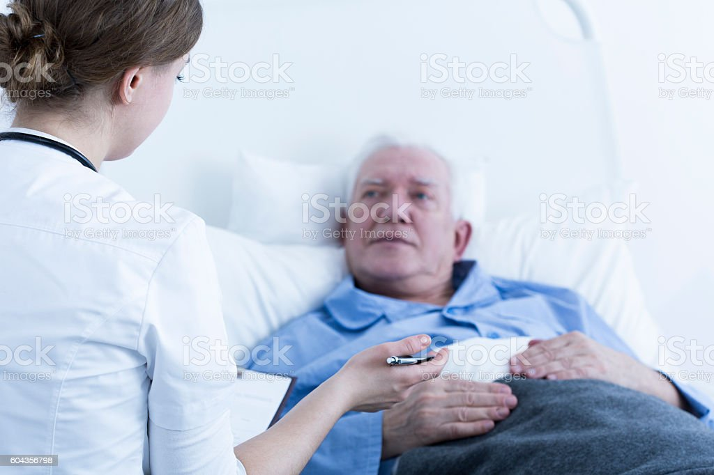 Nurse talking to patient stock photo