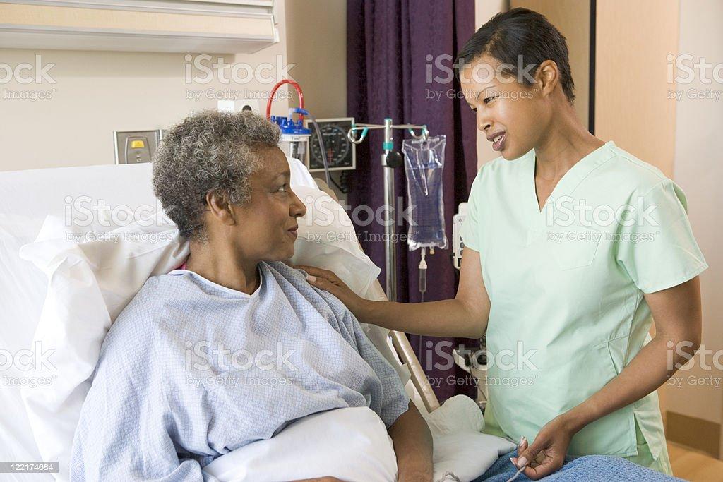 Nurse Talking To Senior Woman royalty-free stock photo