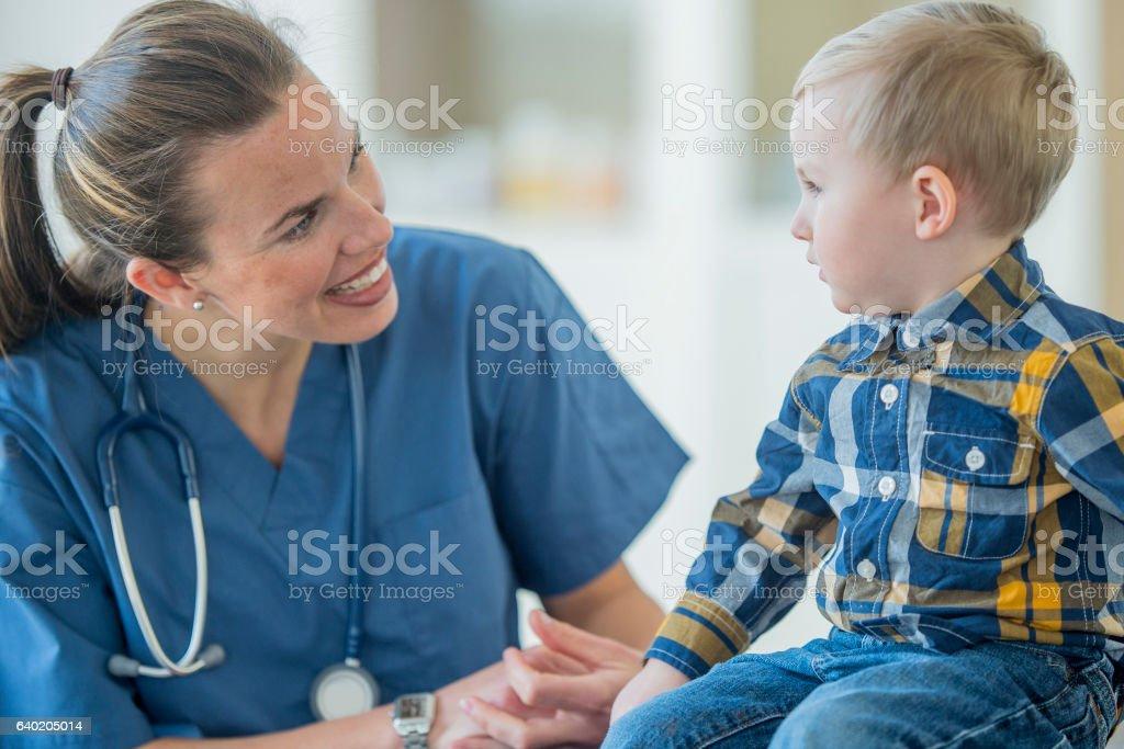 Nurse Talking with a Little Boy stock photo