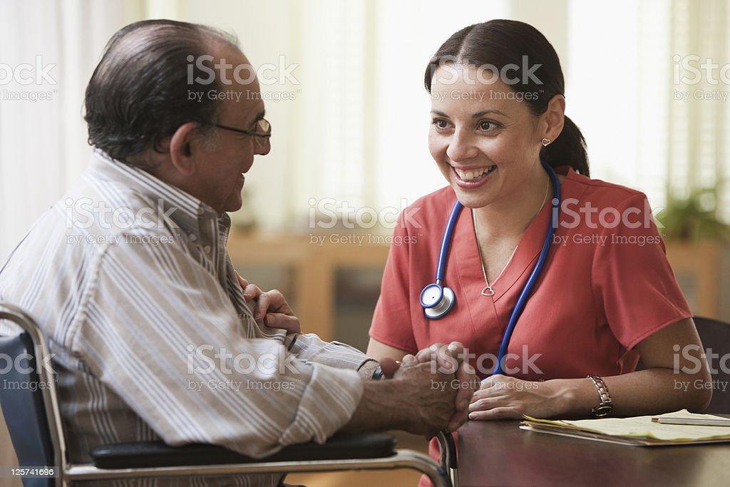 Nurse Talking with an elderly man royalty-free stock photo