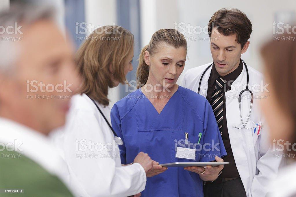 Nurse talking with Doctors stock photo