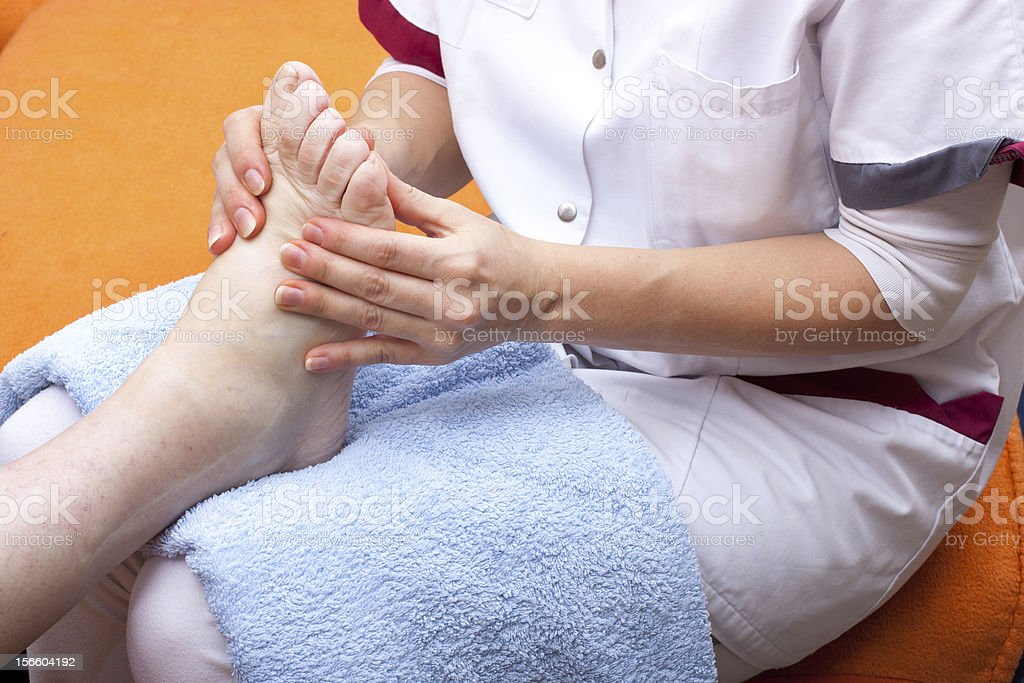Nurse treats a patient's foot royalty-free stock photo