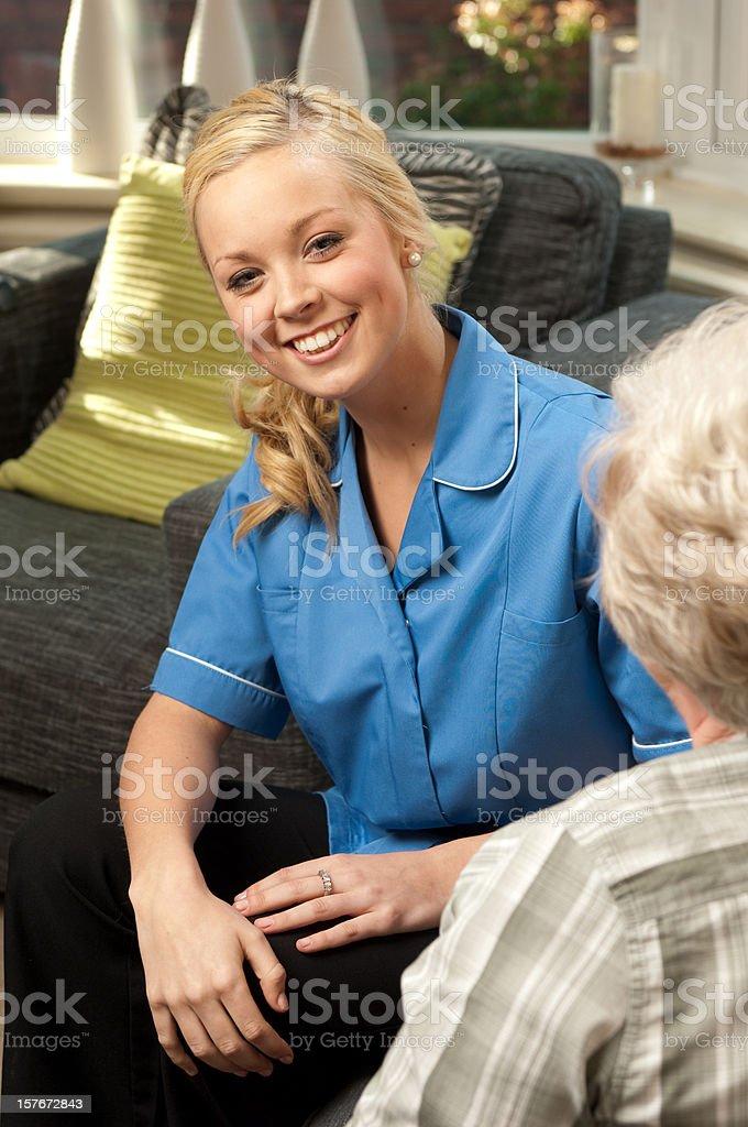 Nurse Visiting an Elderly Woman royalty-free stock photo