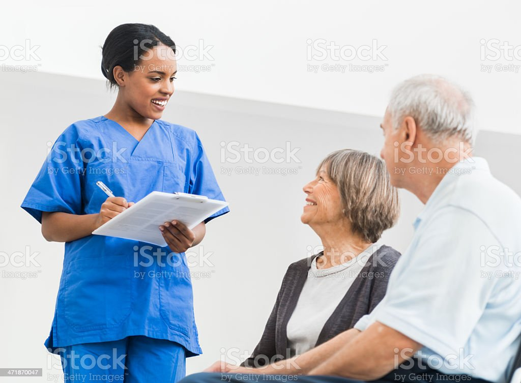 Nurse Welcomes Senior Couple in Hospital stock photo