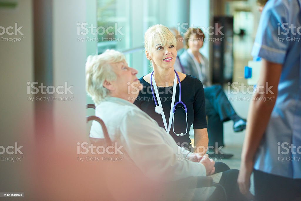 nurse will take you to your ward stock photo