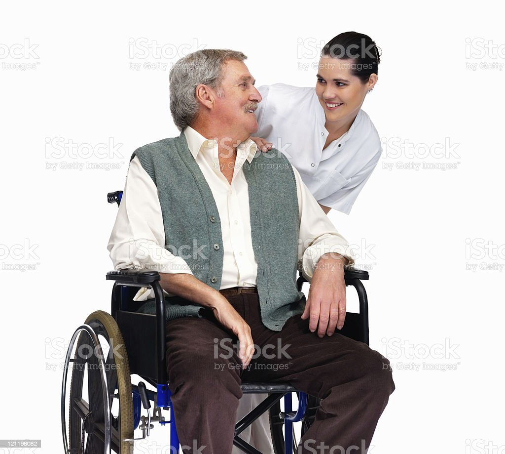 Nurse with a senior man on wheelchair looking at eachother royalty-free stock photo