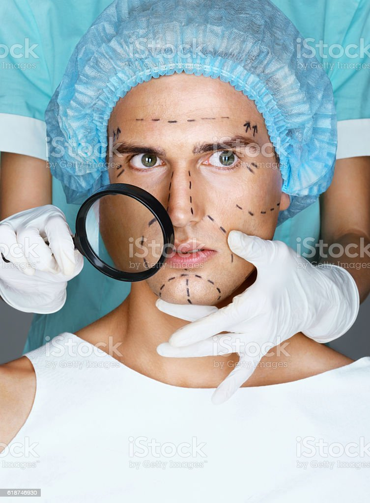 Nurse with magnifying glass near the face stock photo
