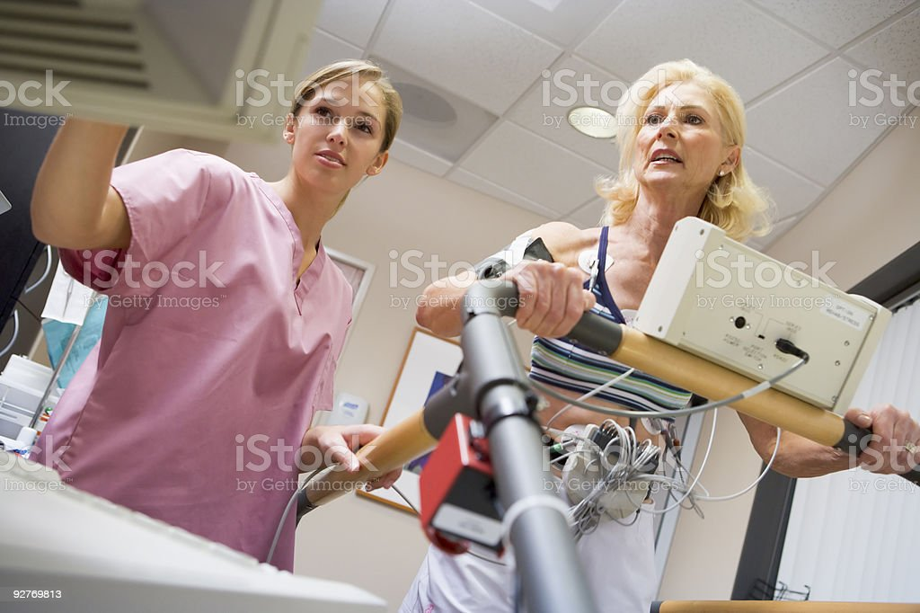 Nurse With Patient During Health Check stock photo