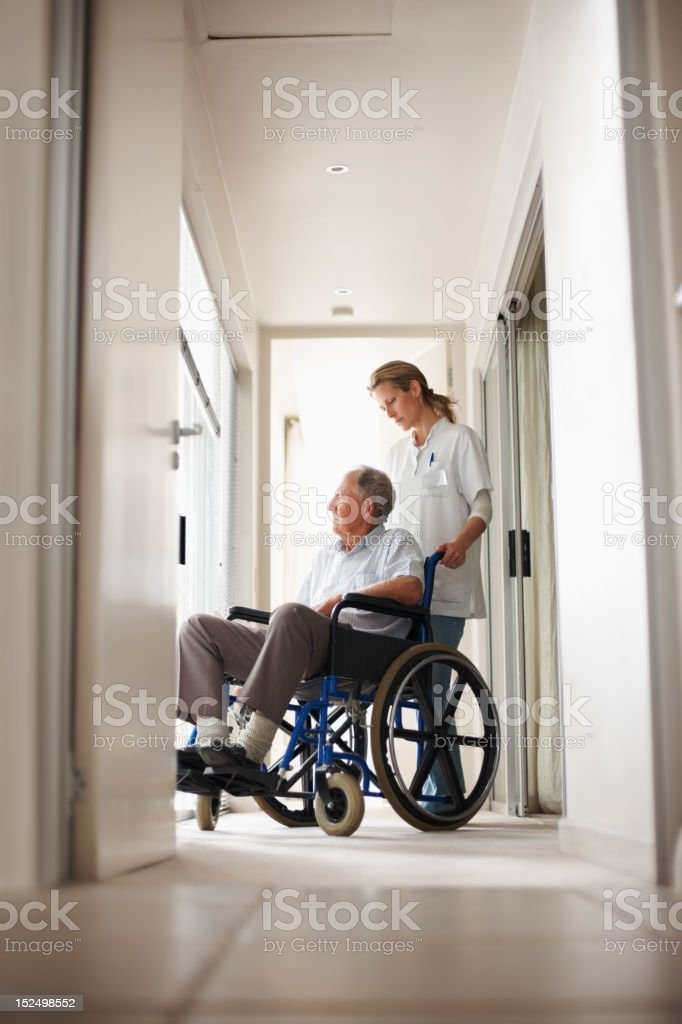 Nurse with patient on wheelchair royalty-free stock photo