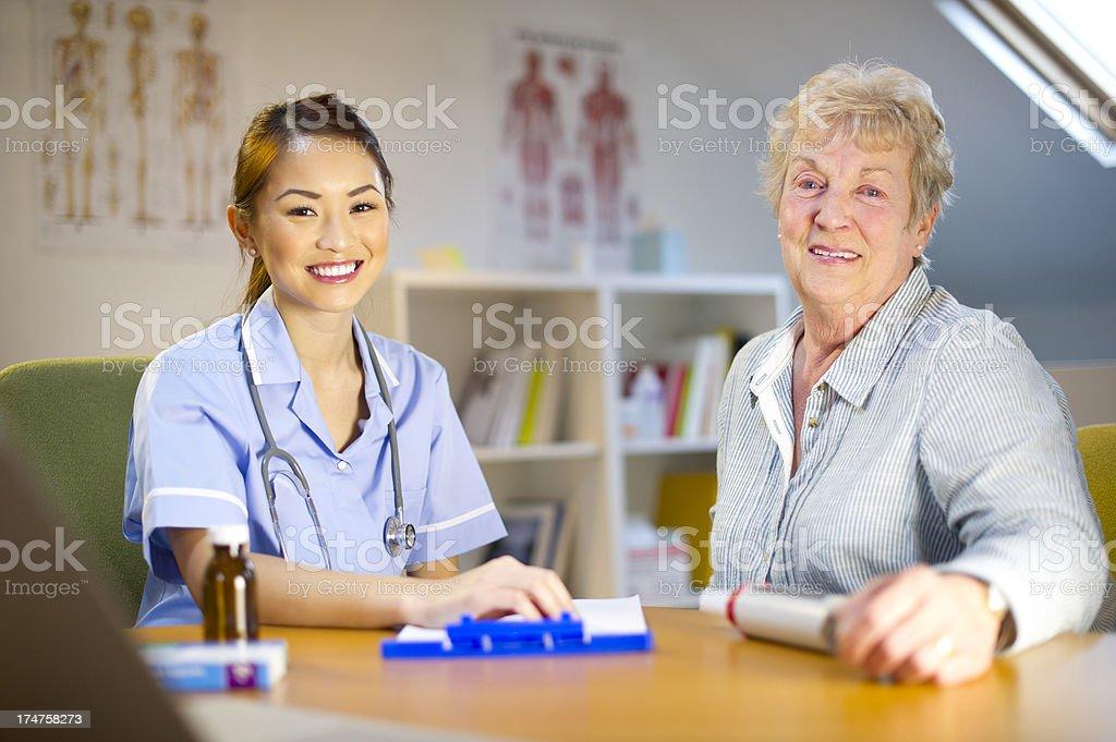 nurse with senior patient royalty-free stock photo
