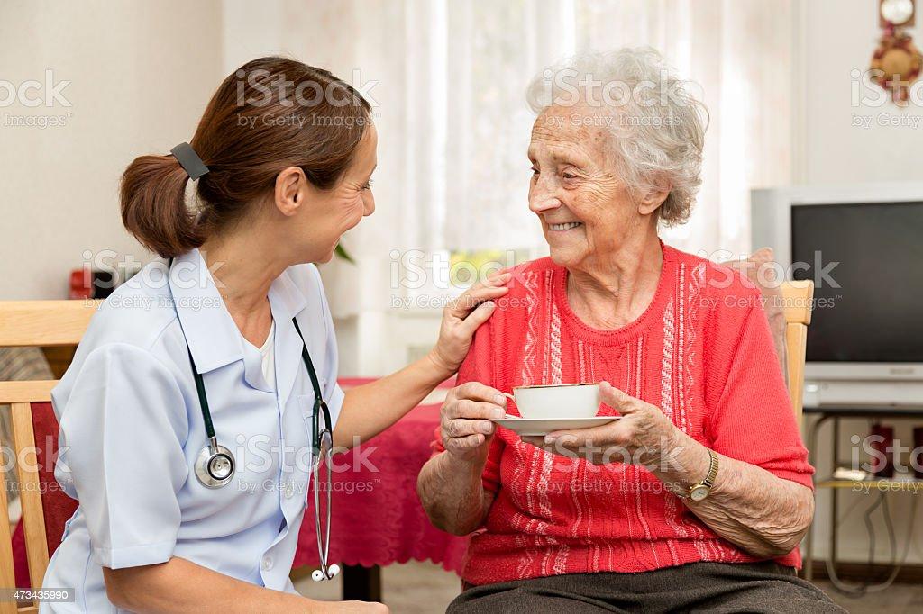 Nurse with Senior Patient stock photo