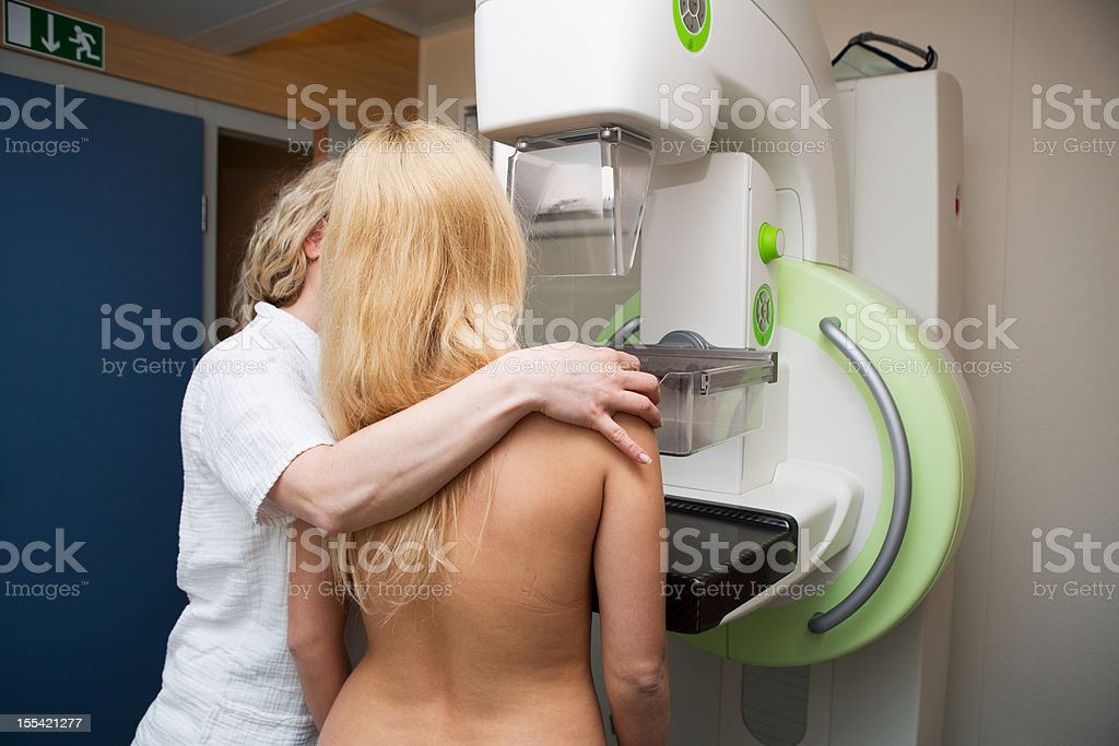 Nurse with young women having a mammography royalty-free stock photo