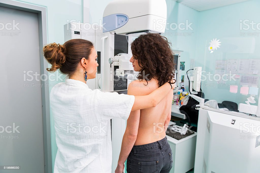 Nurse with young women having a mammography stock photo