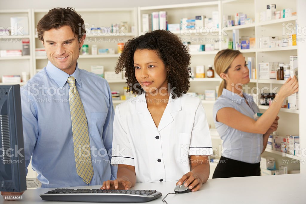 Nurse working on computer in pharmacy royalty-free stock photo