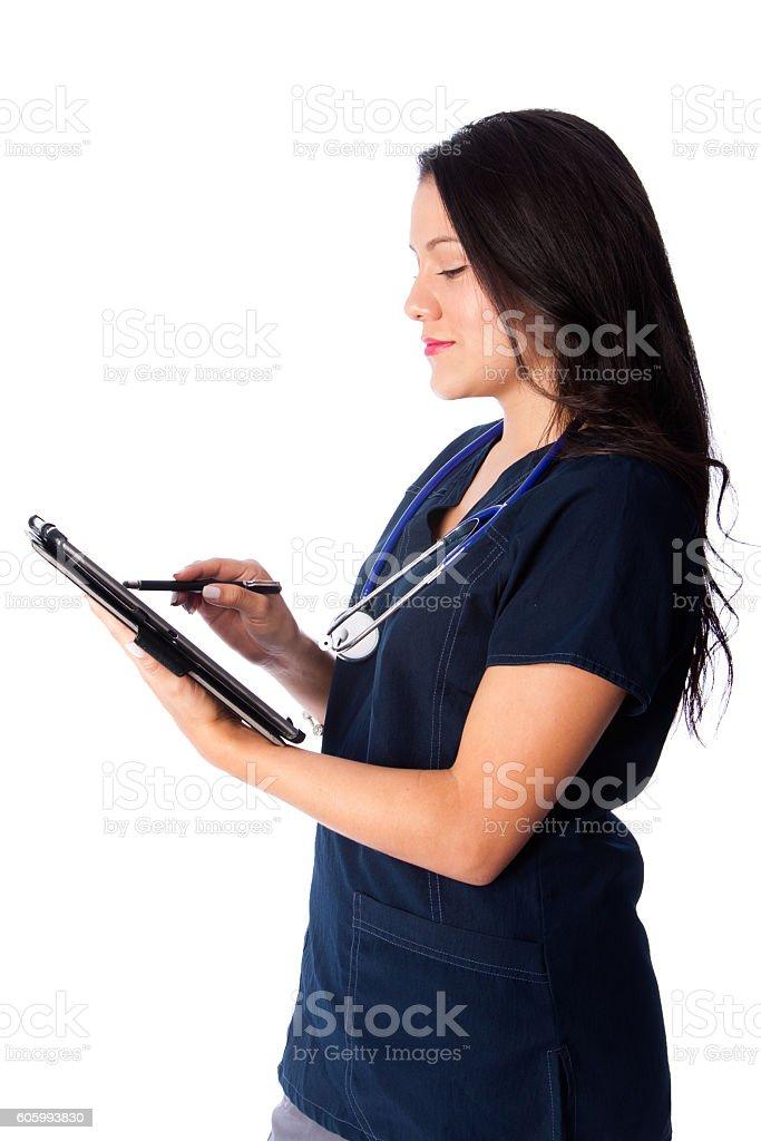 Nurse writing digital patient chart stock photo