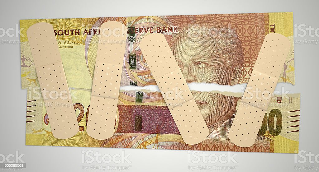 Nursed Torn South African Rand stock photo
